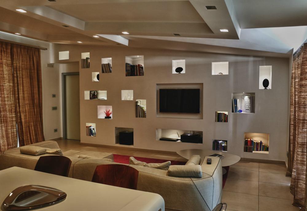 Ristrutturazione e progettazione attico in via roma a caserta - Camera da letto con parete in pietra ...